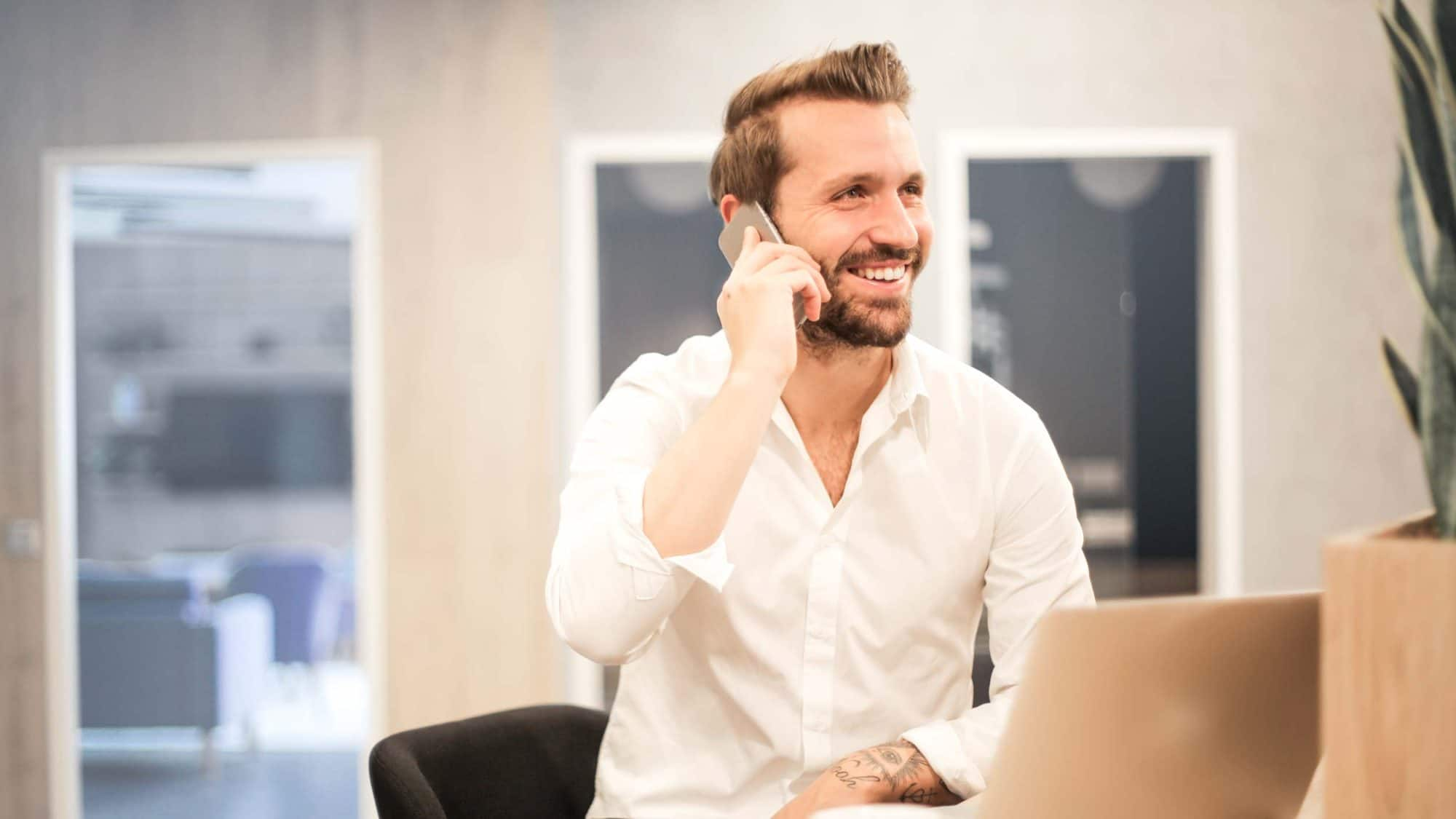 Man holding phone in office