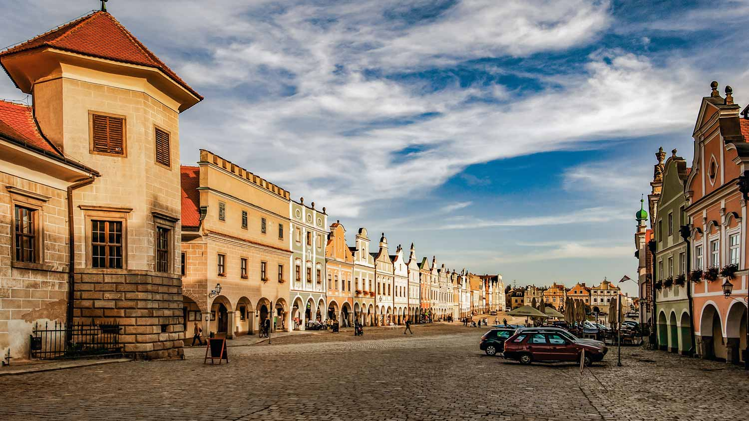 View of the square in Telc with colored houses and a fountain