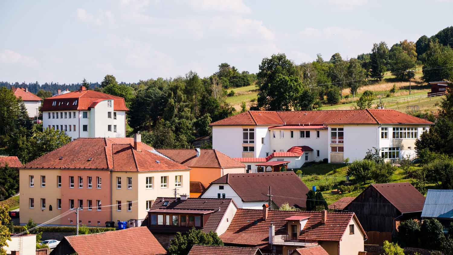 View of the building of the school Strazek on the hill