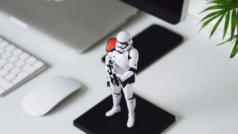 A stormtrooper guarding a computer from attack