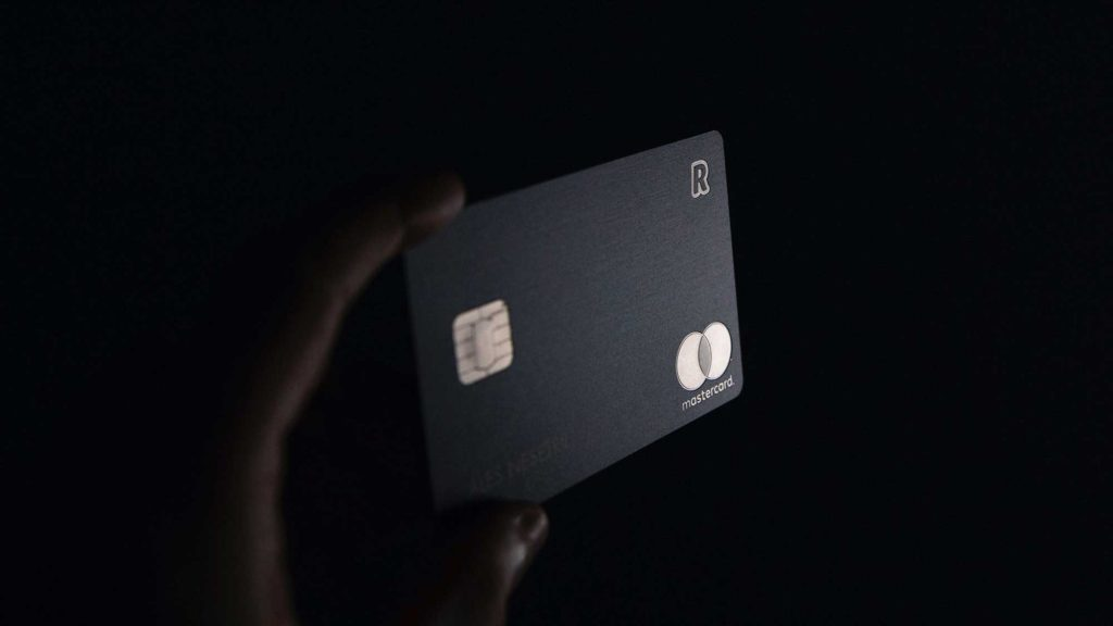Black and gold credit card in dark shadow