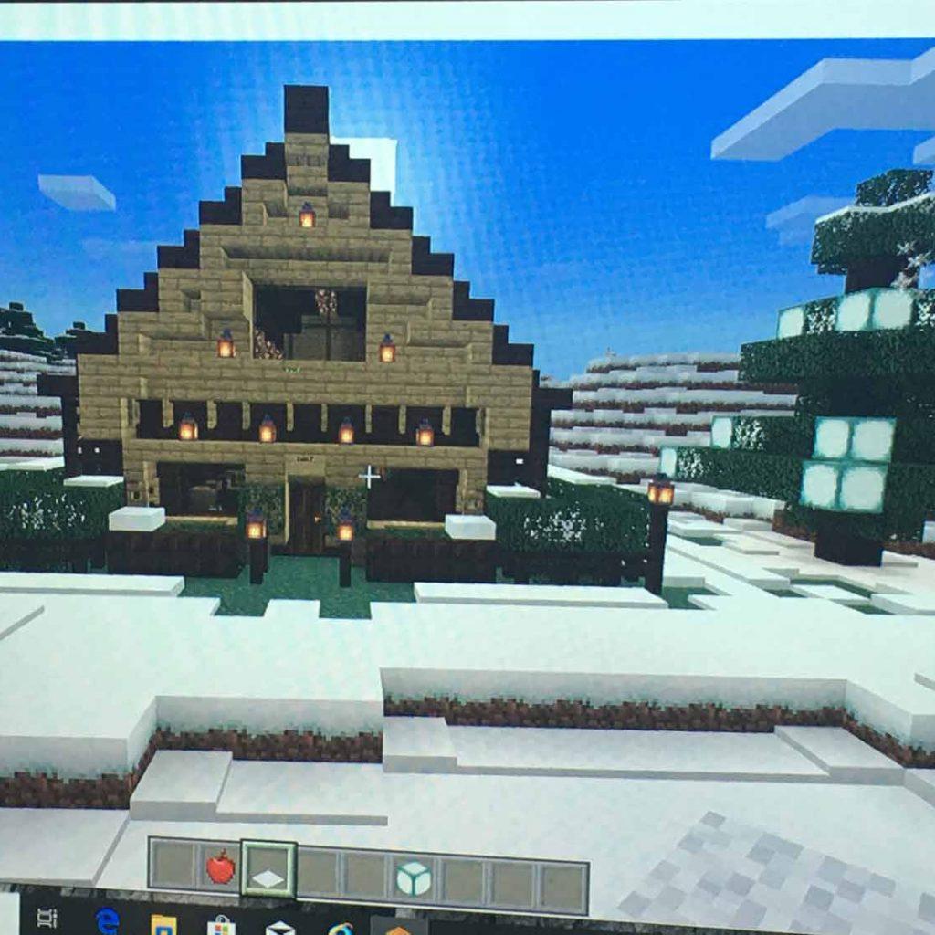 Pohled na obrazovku svánoční scenerií Minecraftu